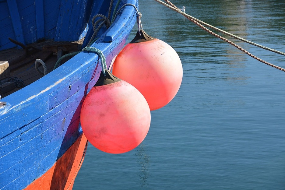Fishing boat with buoys